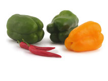 Peppers. Three sweet pepper and two sharp white background Stock Photos