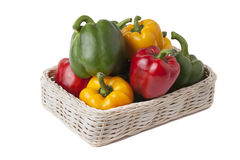 Peppers in basket on white background Stock Photography