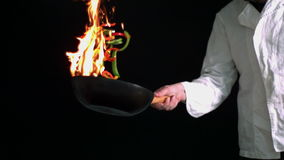 Peppers burning in a pan with large flame Royalty Free Stock Images