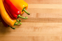 Peppers on a chopping board Stock Photo