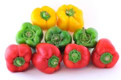 Peppers. A colored peppers isolated on white Royalty Free Stock Image