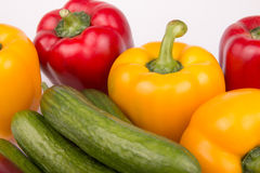 Peppers and cucumbers. Together with white background Stock Photography