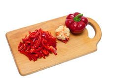 Peppers on cutting board Stock Image