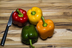 Peppers on Cutting Board Stock Photography