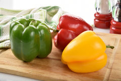 Peppers on a cutting board Stock Photography