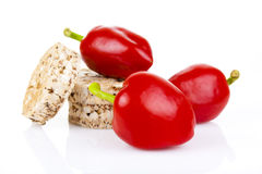 Peppers with dietary loaves of bran Stock Image