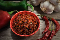 Peppers and dried garlics Royalty Free Stock Photo