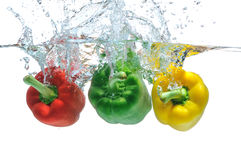 Peppers falling in water Stock Photo