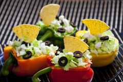 Peppers filled with salad Stock Image