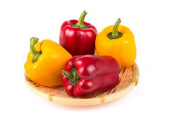 Peppers. Four peppers in the basket Royalty Free Stock Image