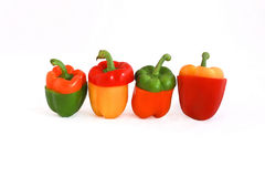 Peppers in four colors. Red, yellow, green, orange Royalty Free Stock Photos