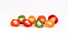 Peppers in four colors. Red, yellow, green, orange Royalty Free Stock Photo