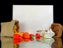 Peppers and garlic. With text Peppers on a white board stock photography