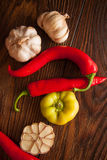 Peppers&garlic. Vegetables fir flavouring: peppers and garlic Royalty Free Stock Image