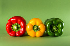 Peppers on Green Background Royalty Free Stock Photos