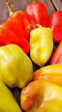 Peppers. Green and red peppers lying on the autumn table Stock Photo