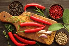 Peppers and herbs Stock Images