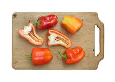 Peppers on kitchen cutting board isolated Stock Photo