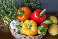 Peppers, lemons, garlic and aromatic herbs in the kitchen Stock Photos