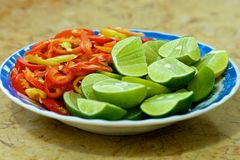 Peppers and Limes Stock Photography