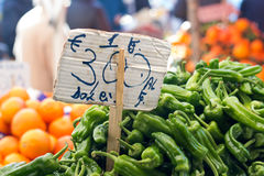 Peppers on a market. With price tag Royalty Free Stock Photography