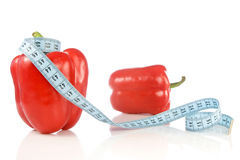 Peppers with measuring tape Stock Photos