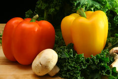 Peppers and Mushroom. Bell Peppers and Mushroom on Kale Stock Images