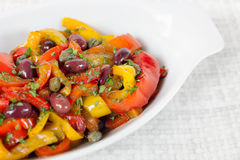 Peppers with olives and capers, close-up Stock Photo
