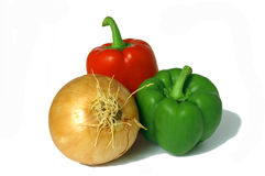 Peppers & onion. Red and green peppers with an onion Stock Photography