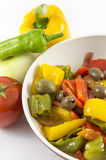 Peppers, onions, tomatoes and olives. A bit of olive oil and there you have a nice flat Royalty Free Stock Image