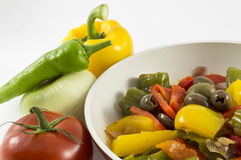 Peppers, onions, tomatoes and olives:ratatouille. Peppers, onions, tomatoes and olives a bit of olive oil and there you have a nice flat Royalty Free Stock Images