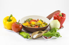 Peppers, onions, tomatoes and olives. A bit of olive oil and there you have a nice flat Royalty Free Stock Photo