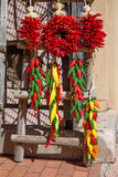 Peppers. Ornamental peppers hanging on a ladder Royalty Free Stock Photography
