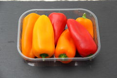 Peppers in packing of plastic trasnparente Stock Photos