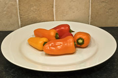 Peppers on plate Royalty Free Stock Photos