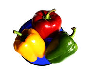 Peppers in the plate, isolated royalty free stock images