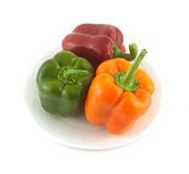 Peppers on plate isolated close up Stock Image