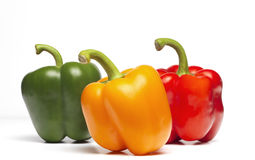 Peppers. Red yellow and green peppers isolated Royalty Free Stock Image