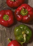 Peppers. Ripe Red and Green Peppers on grunge wooden background Stock Image