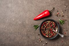 Peppers and rosemary herb for cooking on kitchen table royalty free stock photography