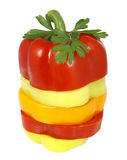 Peppers in slices with a sprig of parsley Royalty Free Stock Photo