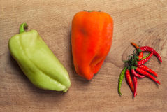 Peppers. Some kinds of pepper on wood table Royalty Free Stock Photography