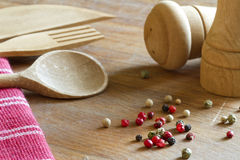 Peppers spice and wooden kitchenware Stock Image
