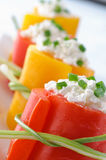 Peppers stuffed with cheese, closeup Royalty Free Stock Photos