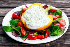 Peppers stuffed with cottage cheese, parsley, garlic. Stock Images