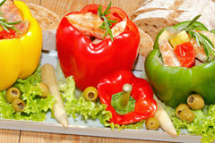 Peppers, stuffed, grilled turkey breast, vegetables, salad Stock Photos