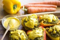 Peppers stuffed with quinoa and avocado pesto Stock Photos