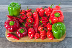 Peppers. Sweet and hot peppers on the board stock photography