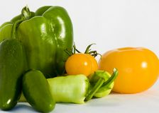 Peppers and tomatoes. Variety of tomatoes and peppers stock photo