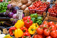 Peppers, tomatoes, eggplant at a market Stock Photography
